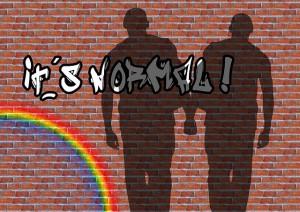 Schatten zweier Mänenr auf einer Wand mit Regenbogen